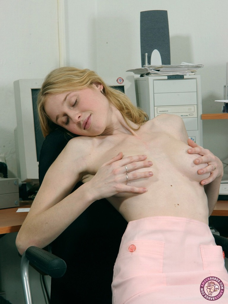 Busty first timer spreads her pussy lips after disrobing in her office
