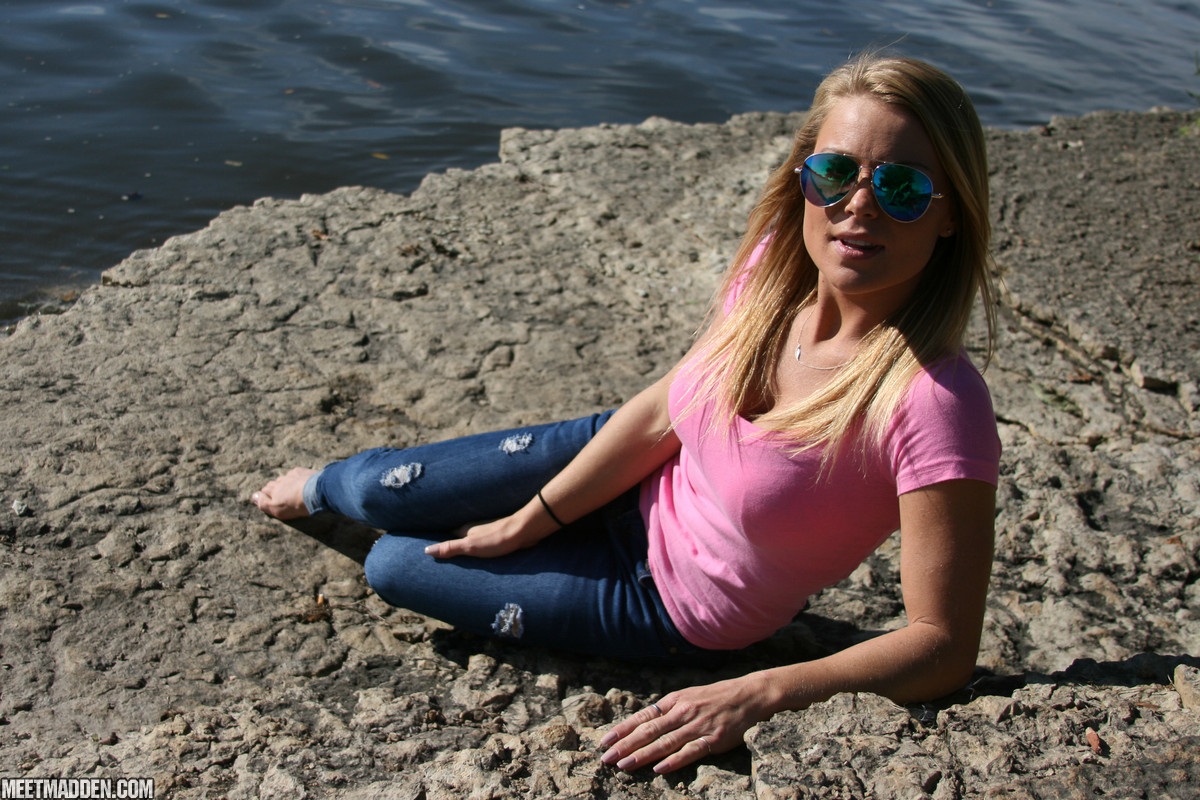 Blonde amateur exposes her lace underwear during waterside walk in blue jeans