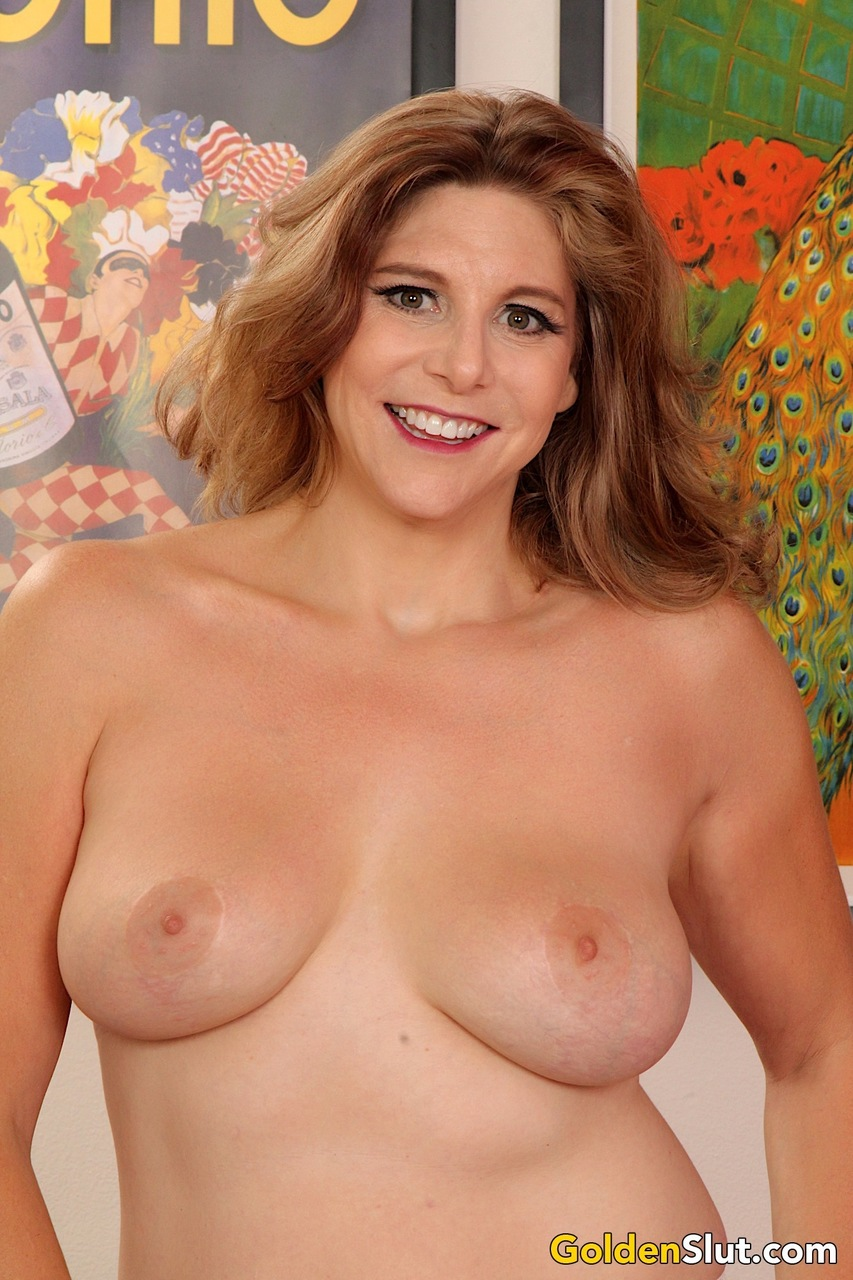 Thick older woman Jade Blissette goes topless while spreading her snatch