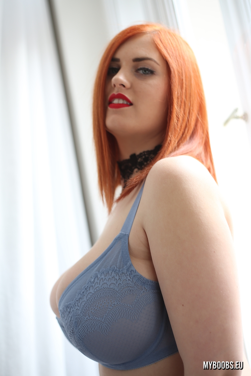 Chubby redhead Alexsis Faye uncups her huge tits in black stockings