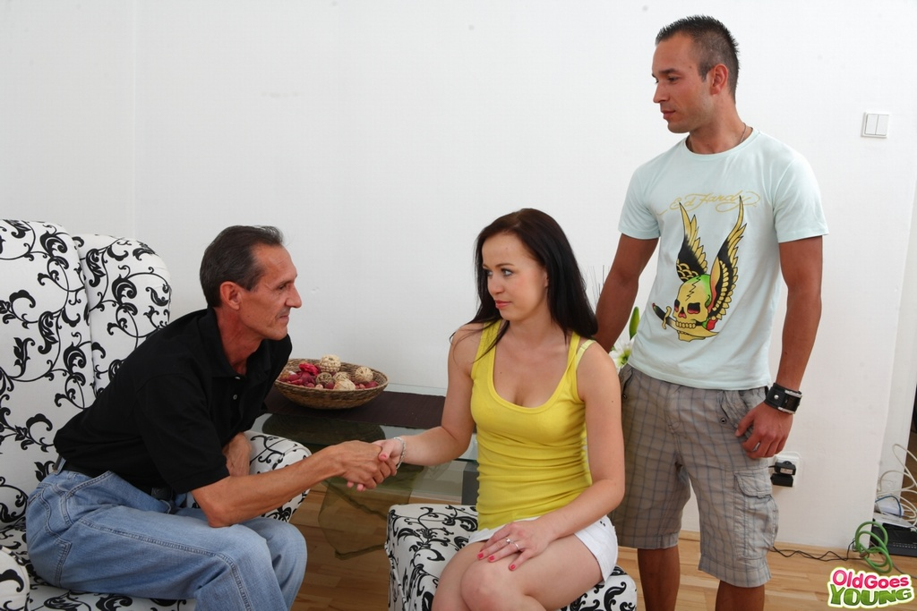 Young brunette receives open mouth facial from her boyfriends stepfather