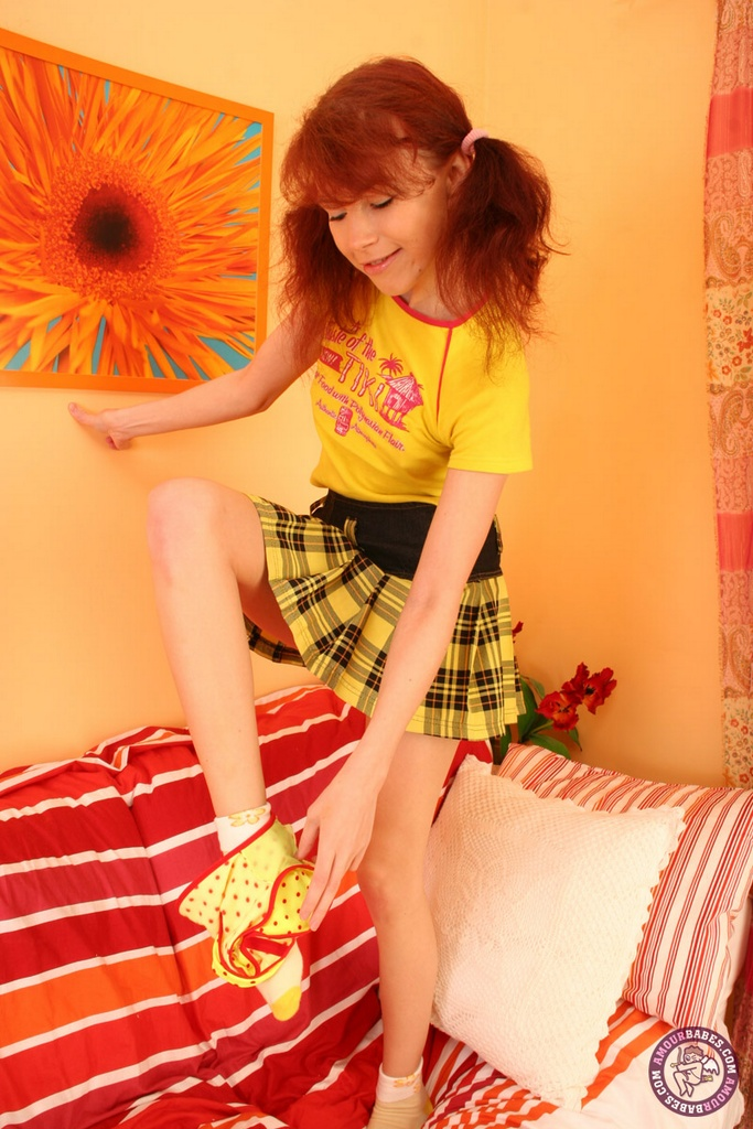 Young looking redhead Aicha sheds cute undies before playing with Ben Wa balls