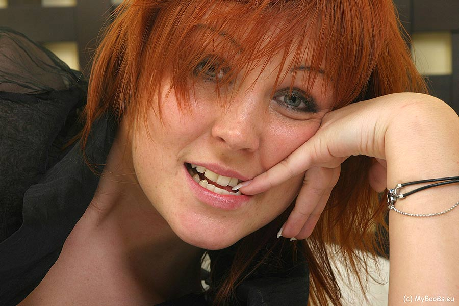 Natural redhead Ania Colette sets her big natural tits free in solo action