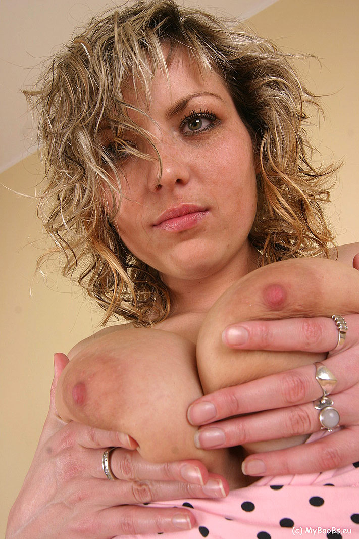 Dirty blonde girl Lana Cant frees her big naturals from polka dot dress