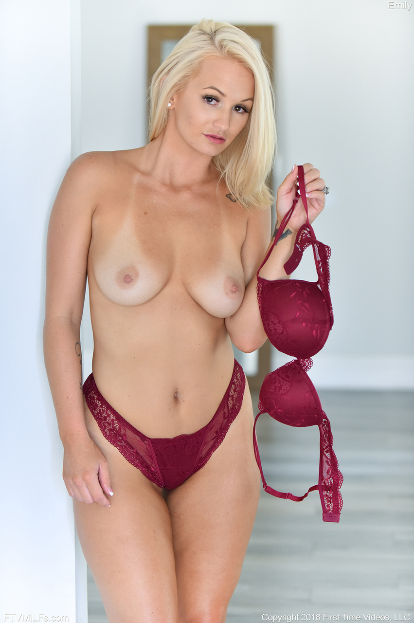 Blonde MILF Danielle removes wine toned lingerie set to pose nude on a chair