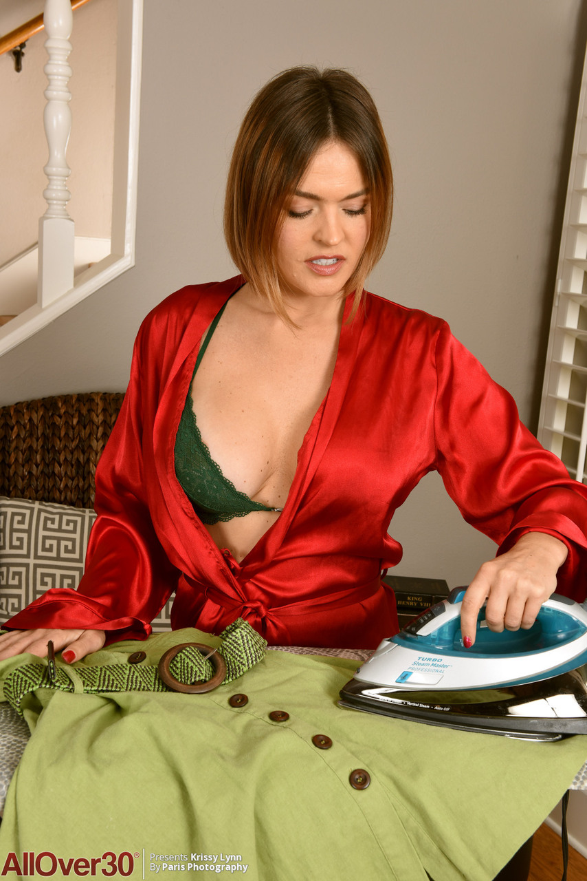 30 plus female Krissy Lynn flaunts her huge tits while getting undressed