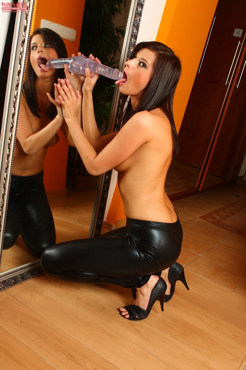 Slim brunette doffs leather pants before pleasuring herself with suction dildo