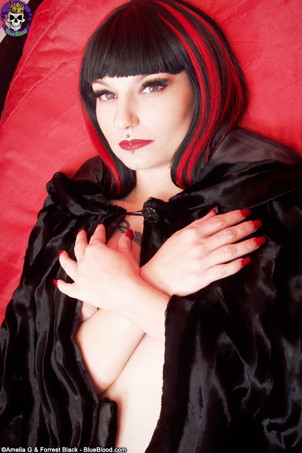 Goth model Nina Sinn dildos her heavily pierced pussy in a coffin