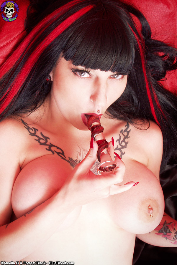 Goth model Nina Sinn dildos her heavily pierced pussy in a coffin ...
