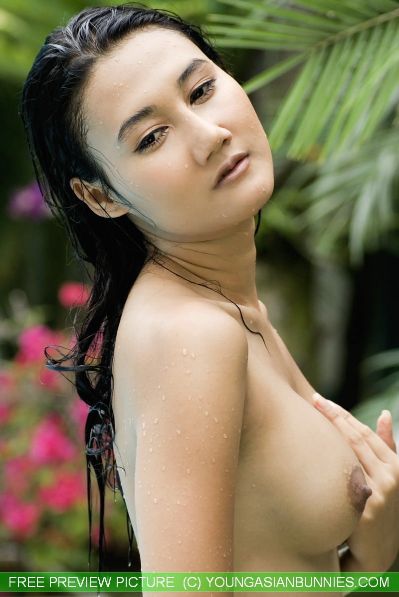 Young Asian girl with firm tits and a full bush swims naked in a pool