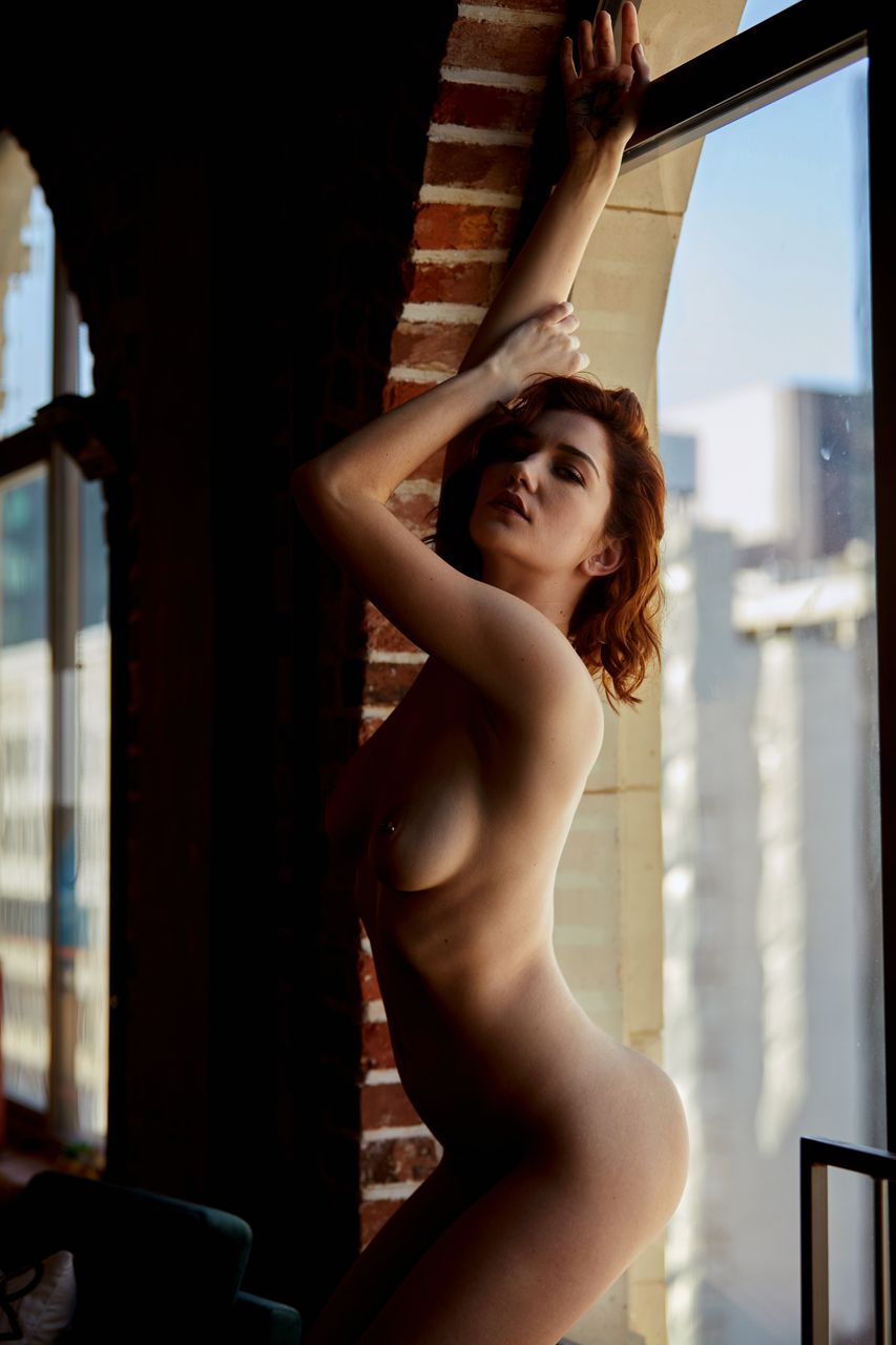 Redhead glam model Eliza Ibarra removes sweater on way to posing naked