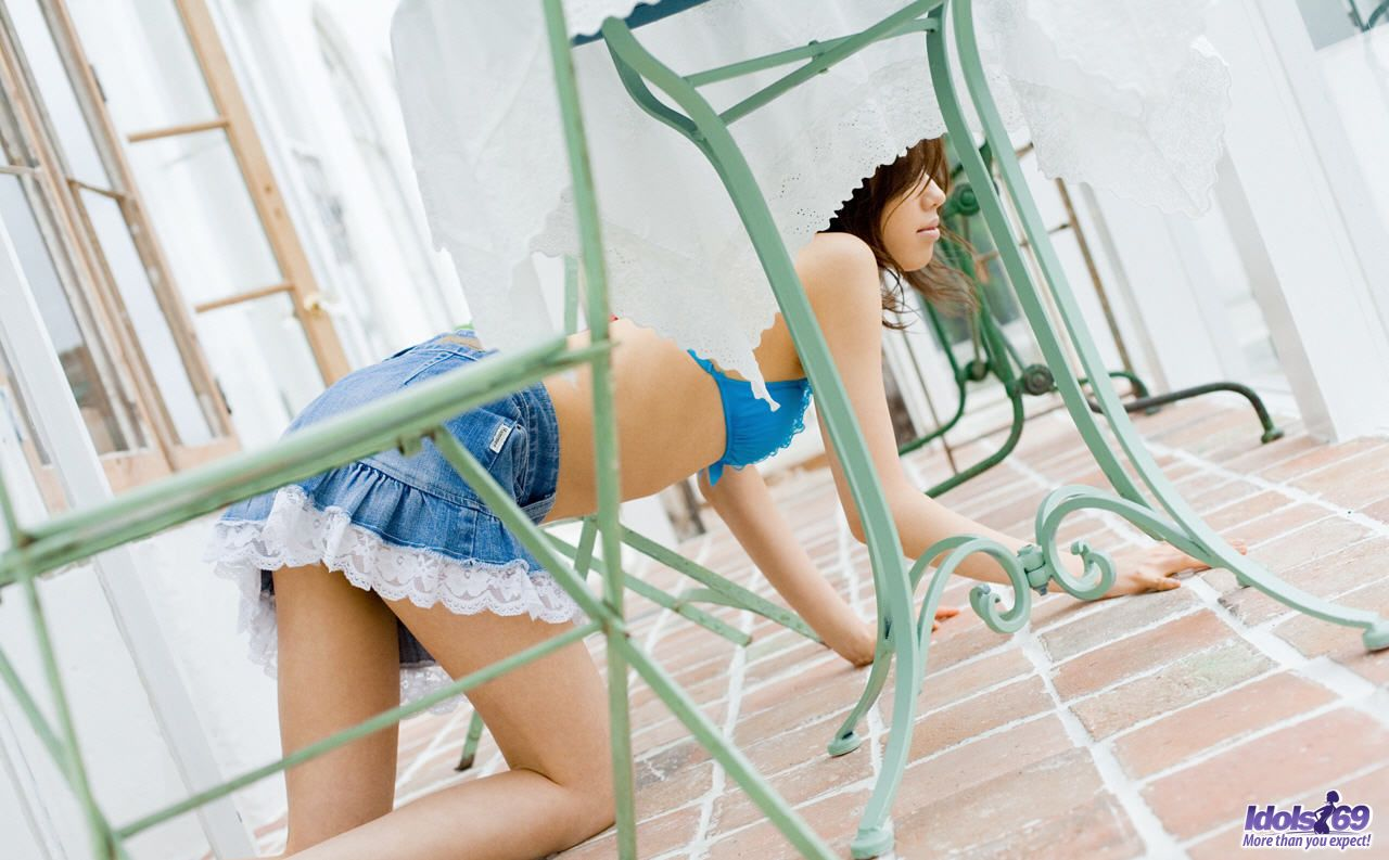 Adorable Japanese teen bares her flat chest prior to pulling down her panties