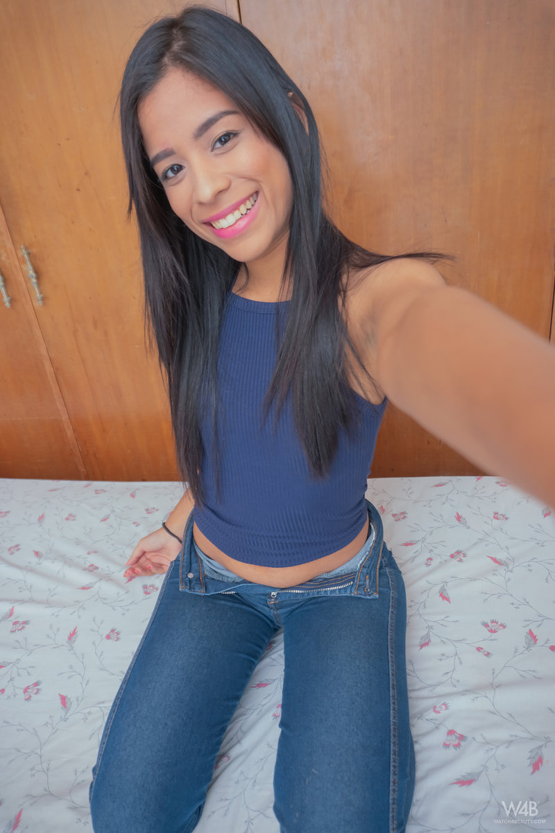 Dark haired Latina teen Karin Torres takes self shots while getting undressed