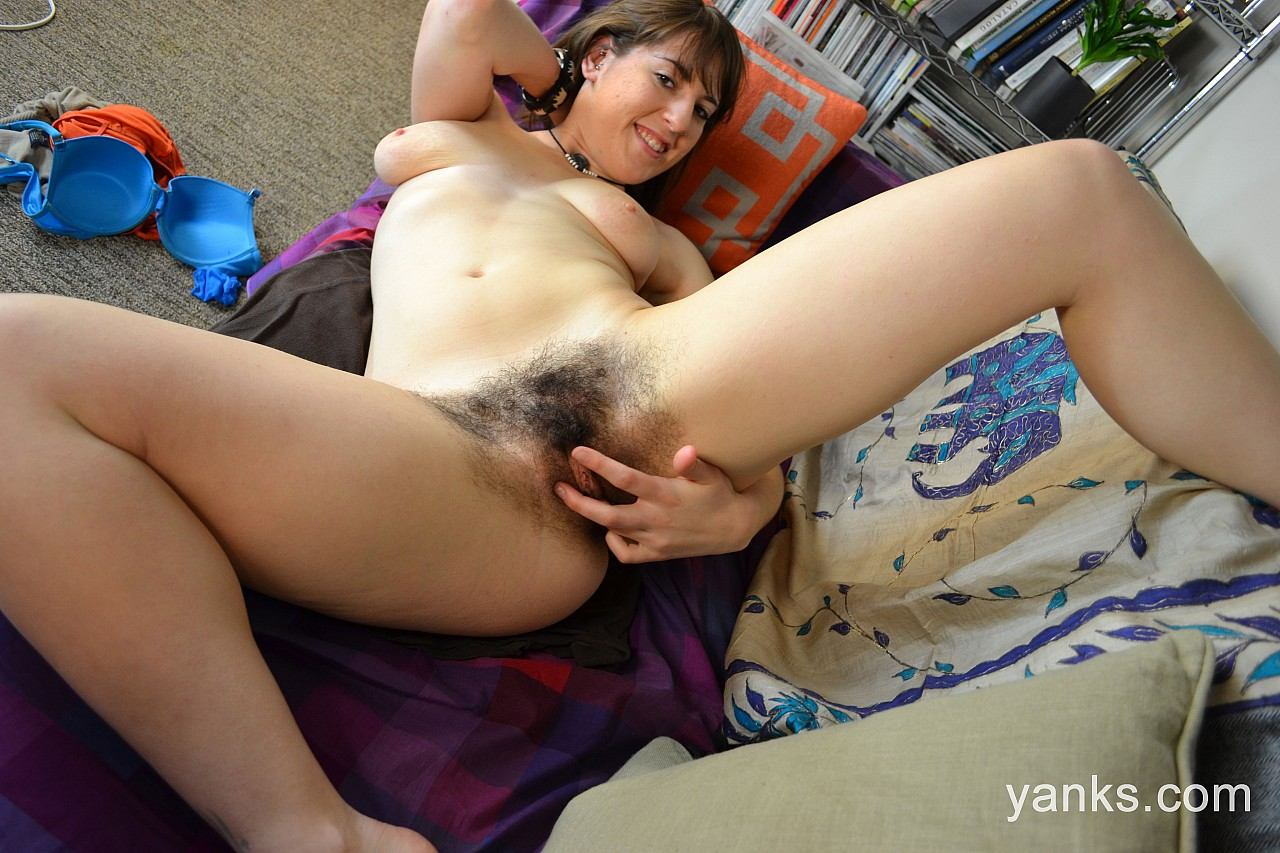 Brunette amateur Amber B plays with her full bush after getting naked