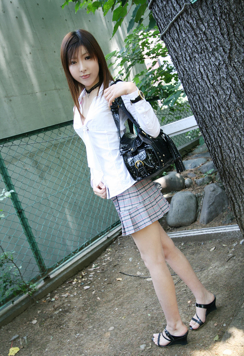 Japanese teen Miyo flashes her tits and panties in solo action