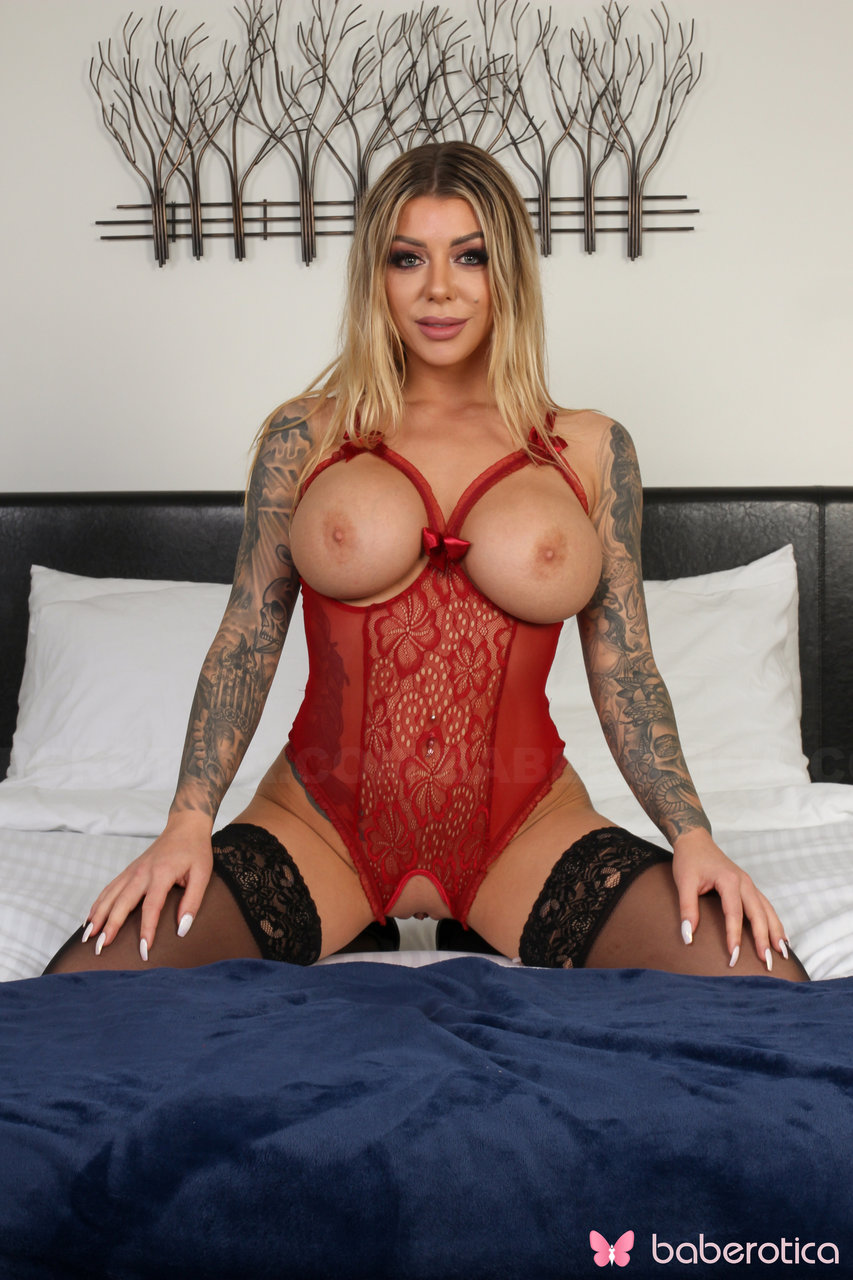 Big titted blonde with tats Karma Rx spits on a dildo before toying her pussy