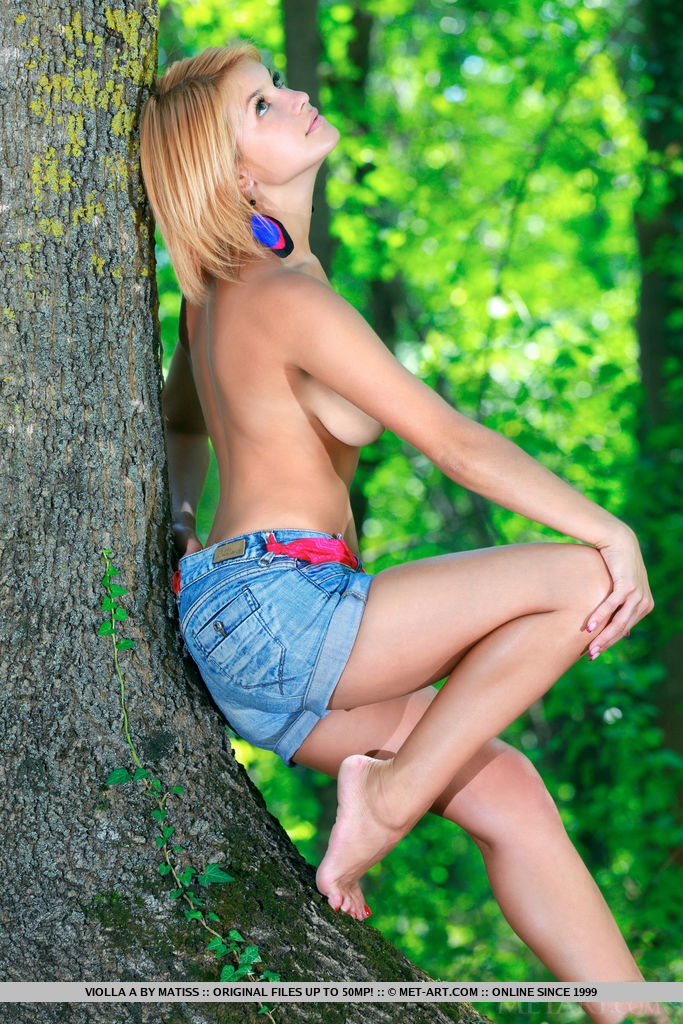 Hot teen Violla A releases her hot body from clothes in old growth forest