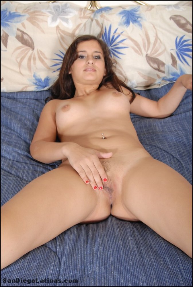 Latina amateur removes sensual lingerie and thong combo to lay naked on a bed