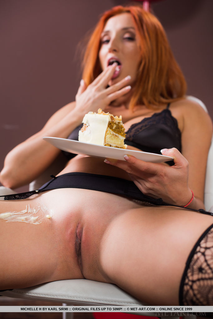 Hot redhead Michelle H shows her bald twat in nylons while eating cake