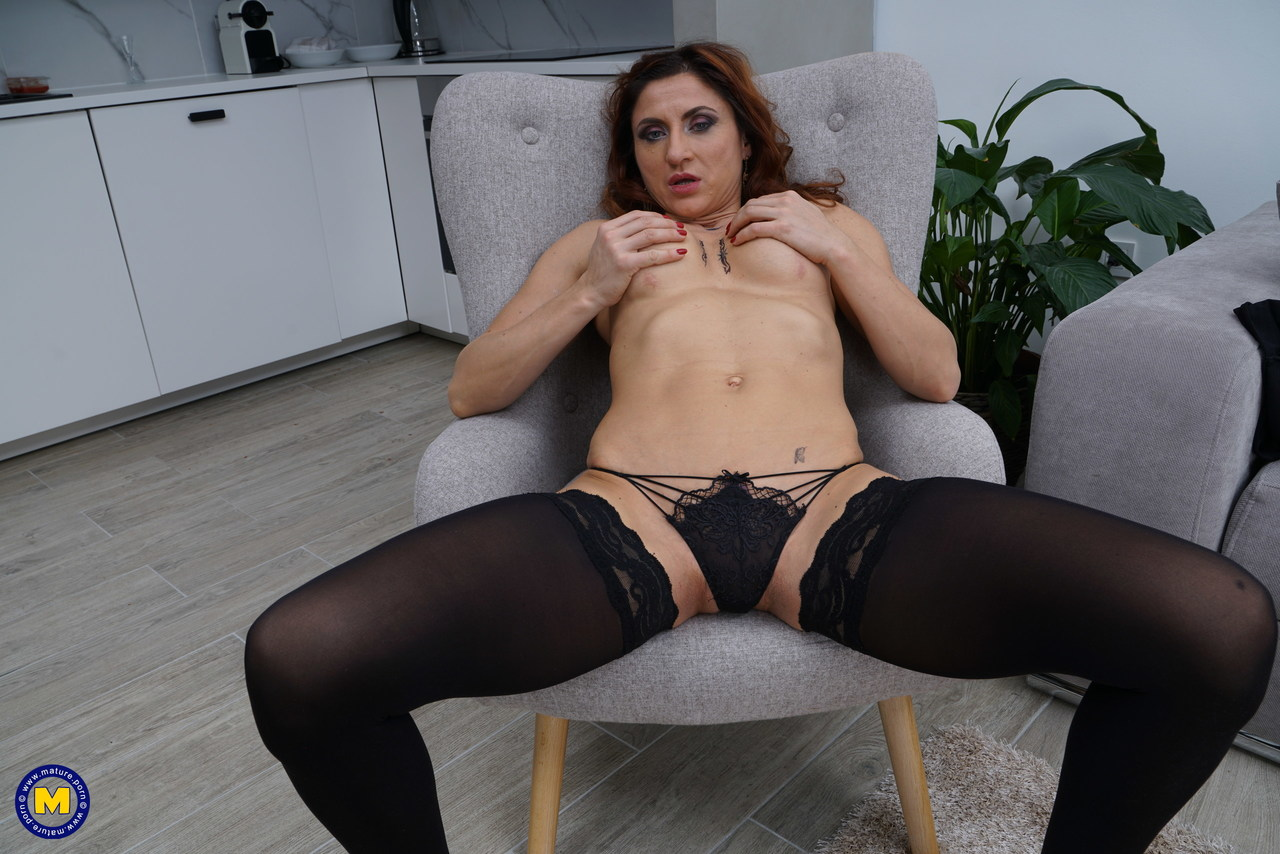 Horny housewife finger fucks after stripping down to black stockings