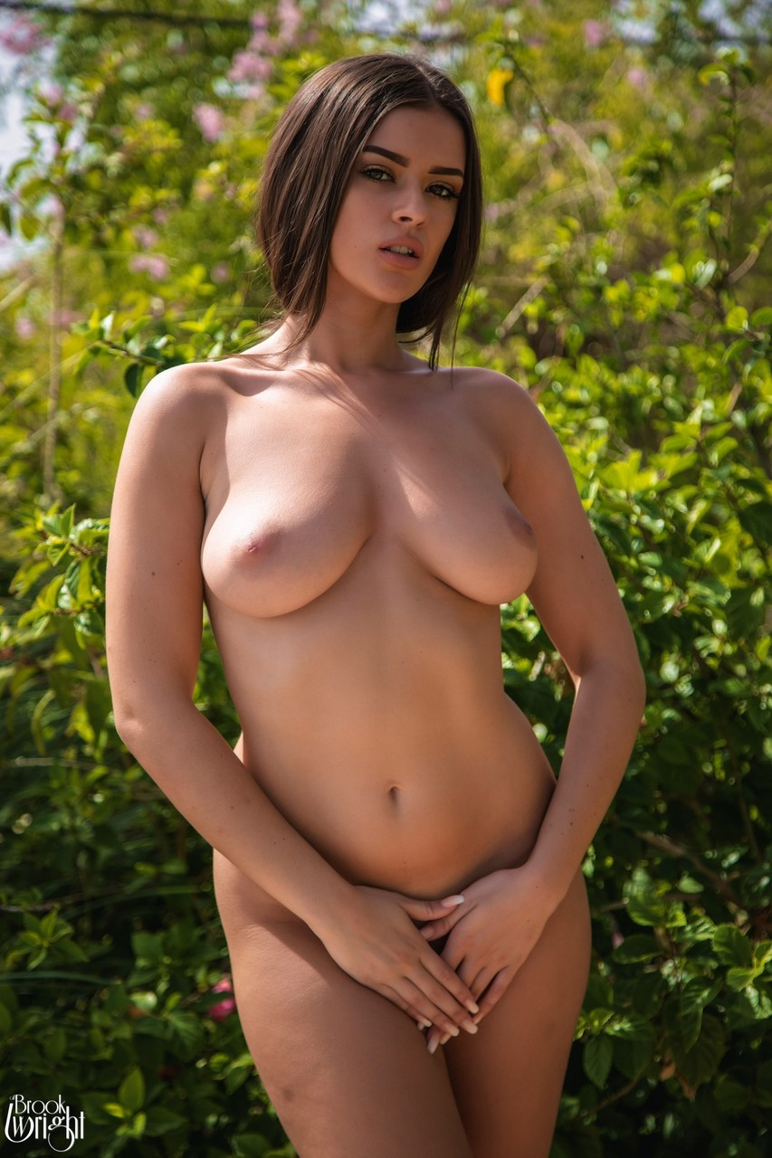 Gorgeous girl Brook Wright unveils her great tits on poolside patio