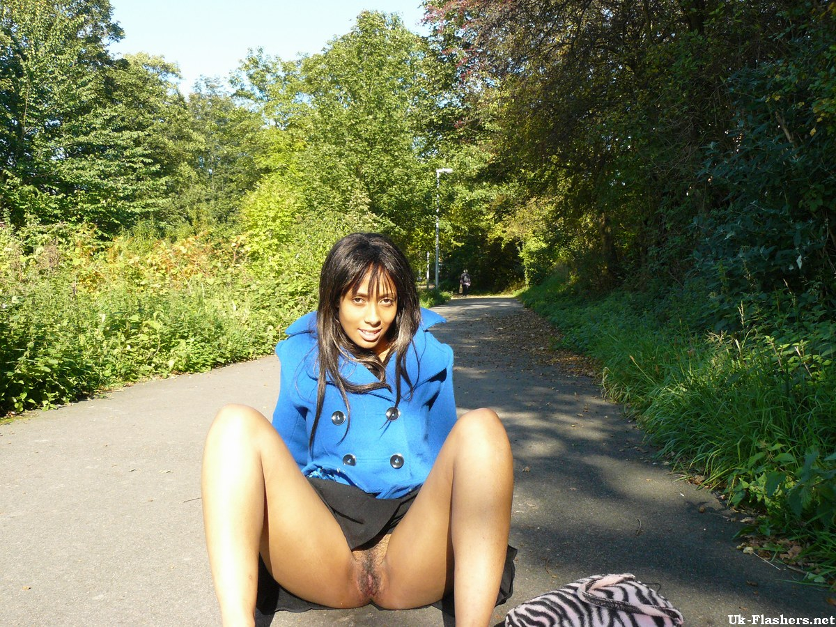Ebony chick fingers her pussy on roadway while a jogger passes by