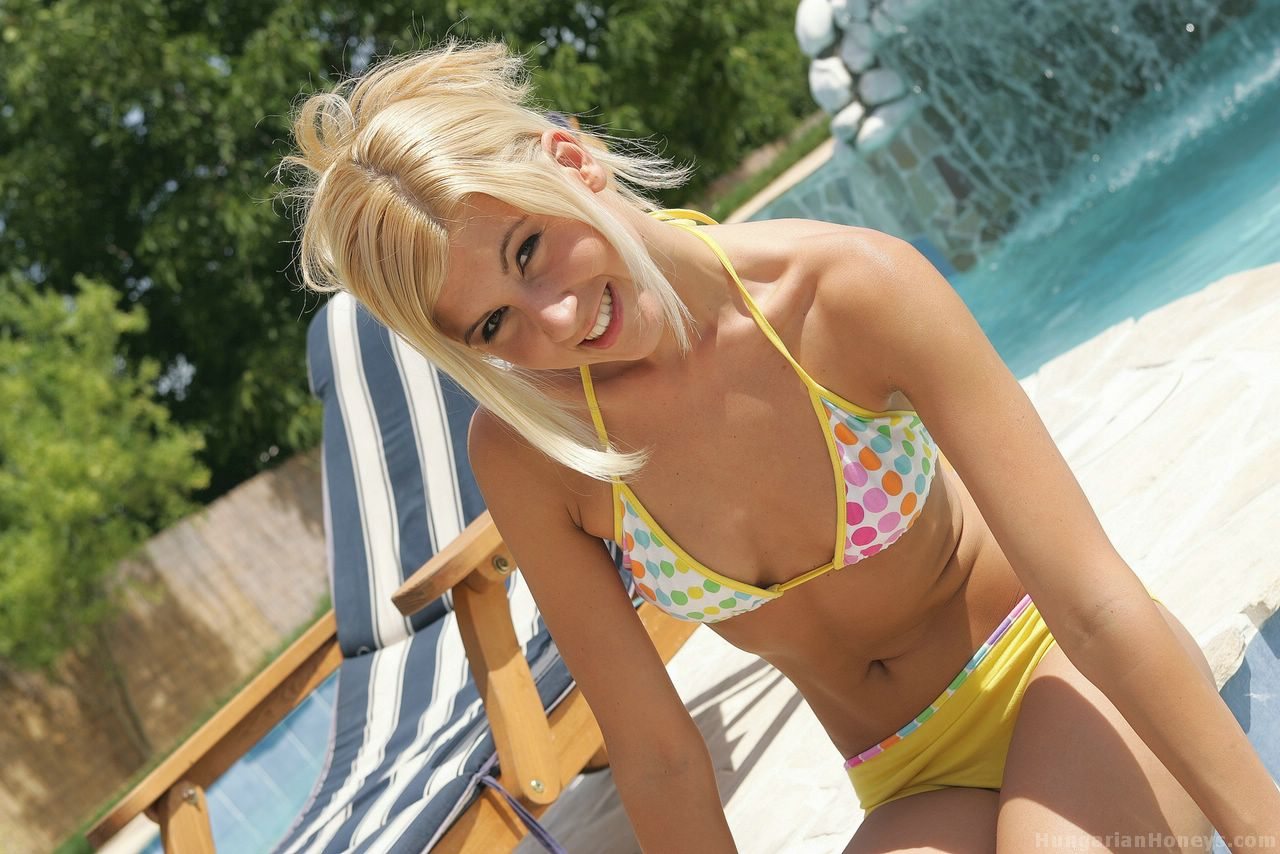 Cute blonde peels off her bikini in the shallow end of a swimming pool