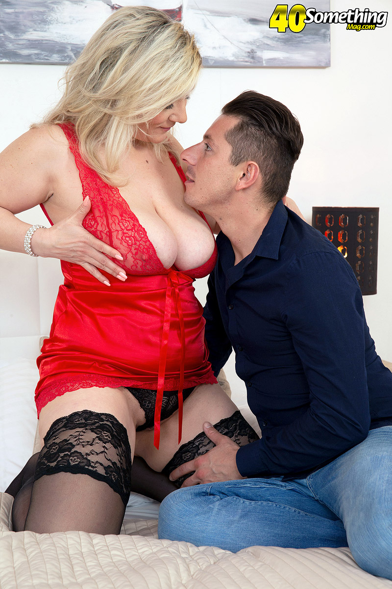 Middle aged blond with big boobs seduces her man in red lingerie and stockings