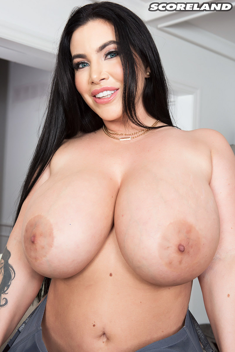 Thick female Korina Kova unleashes her big tits and booty as she gets naked