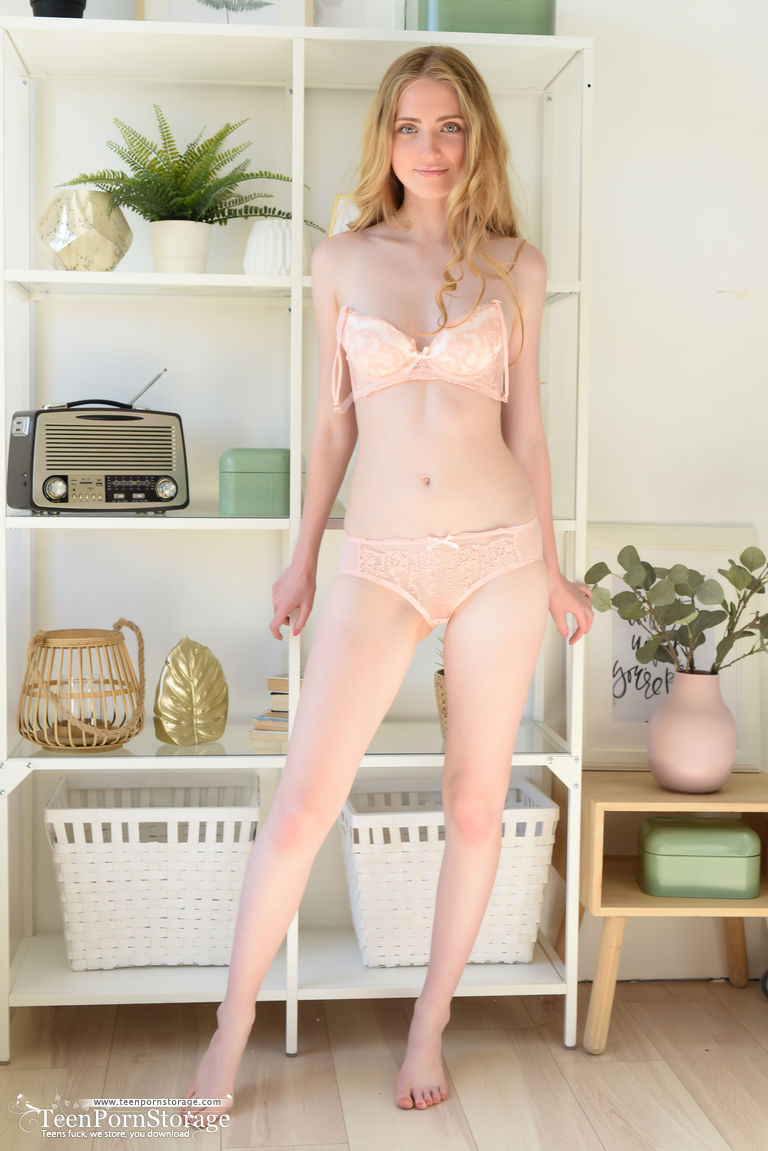 Fair skinned girl works her slender body free of lace bra and panty set