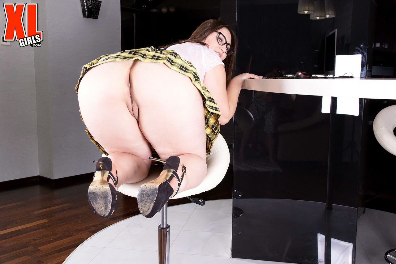Thick nerd Ivanna Lace flashes her big butt before unleashing her huge boobs