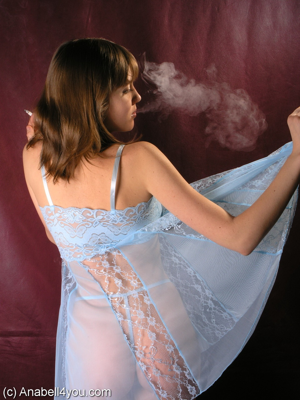 Solo girl Annabell flashes her panties while smoking in sheer lingerie