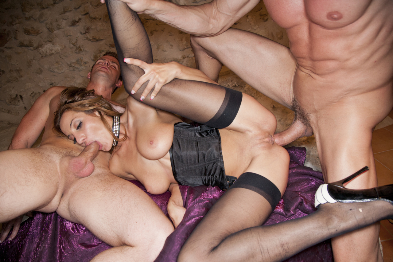 Pornstar Alice Romaine gets banged by two guys in red soled heels and nylons