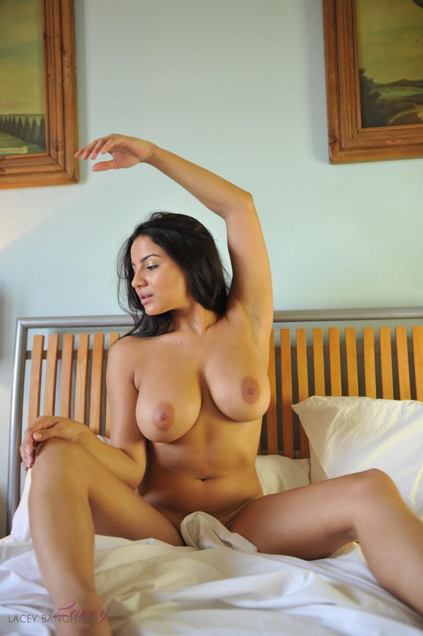 Hot brunette Lacey Banghard exposes her large boobs in front of a mirror