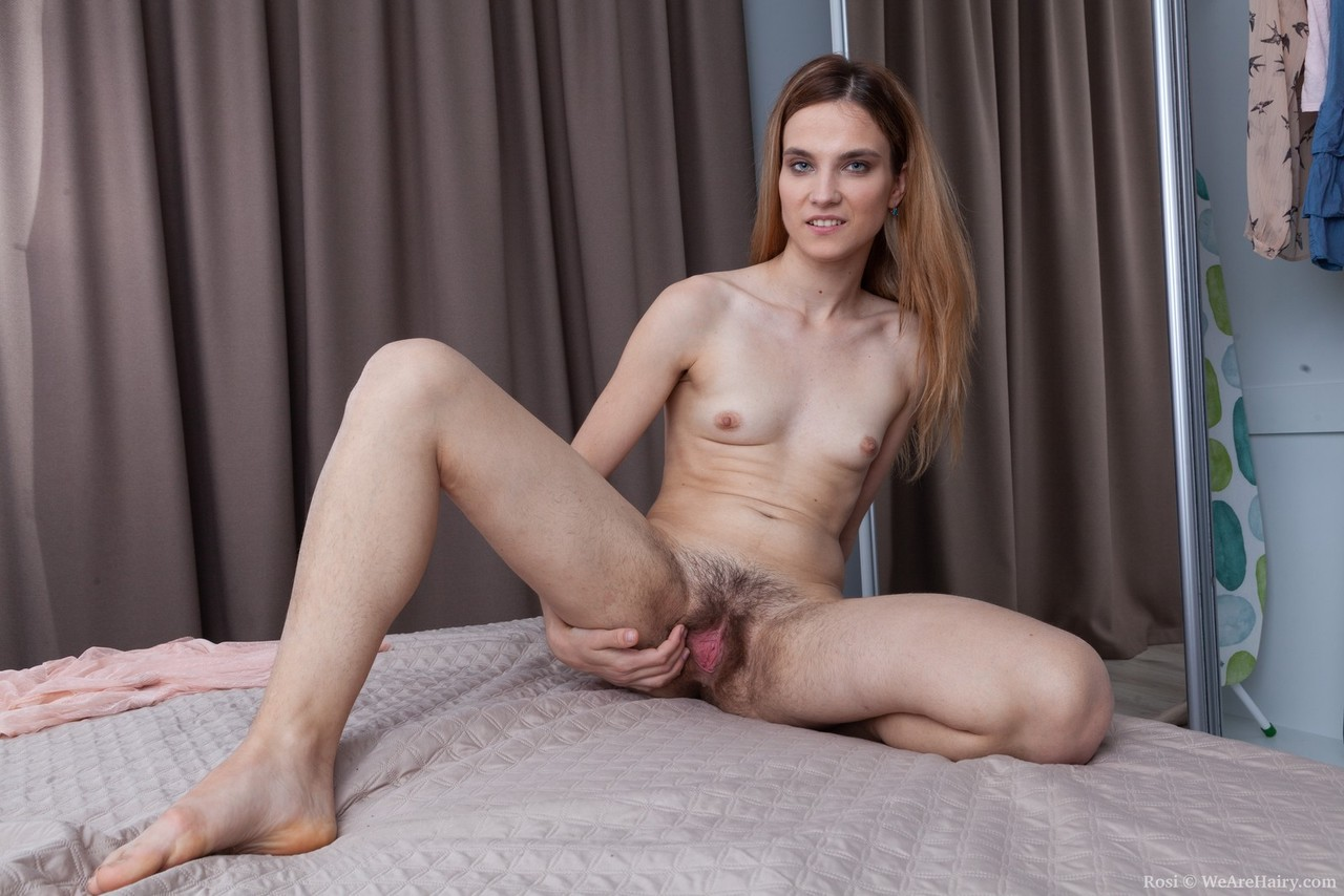 First timer Rosi reveals her tiny tits before spreading her all natural pussy