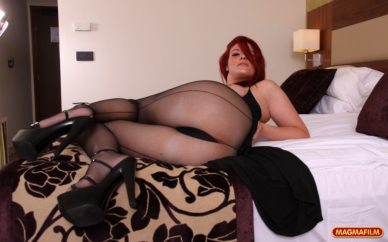 Thick redhead Lula Boops is left with a gaped vagina after fucking in her hose