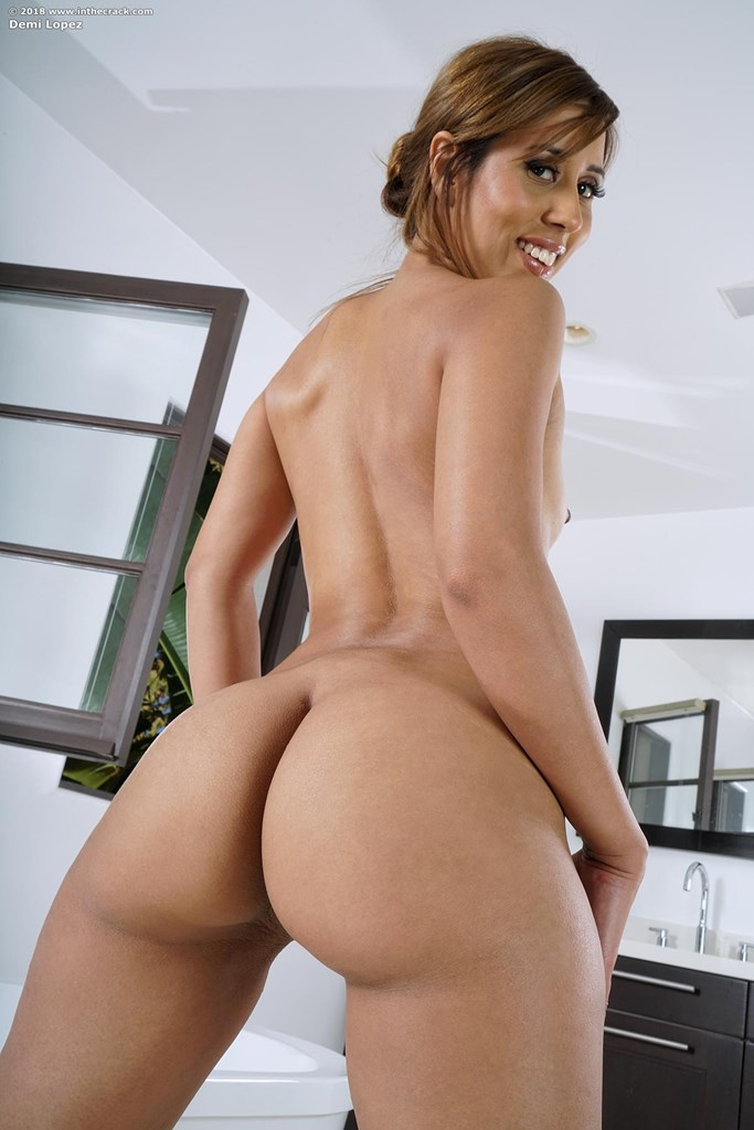 Hot Latina model Demi Lopez grabs her ass to die for while showing her pussy