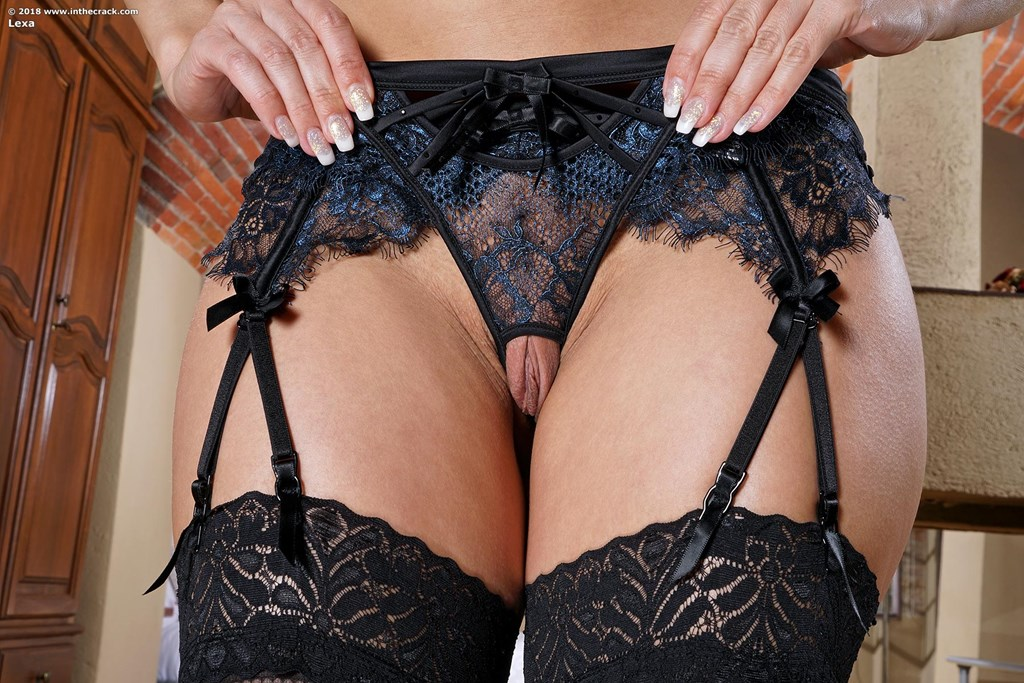 Tall girl Lexa removes crotchless panties before toying her naked pussy
