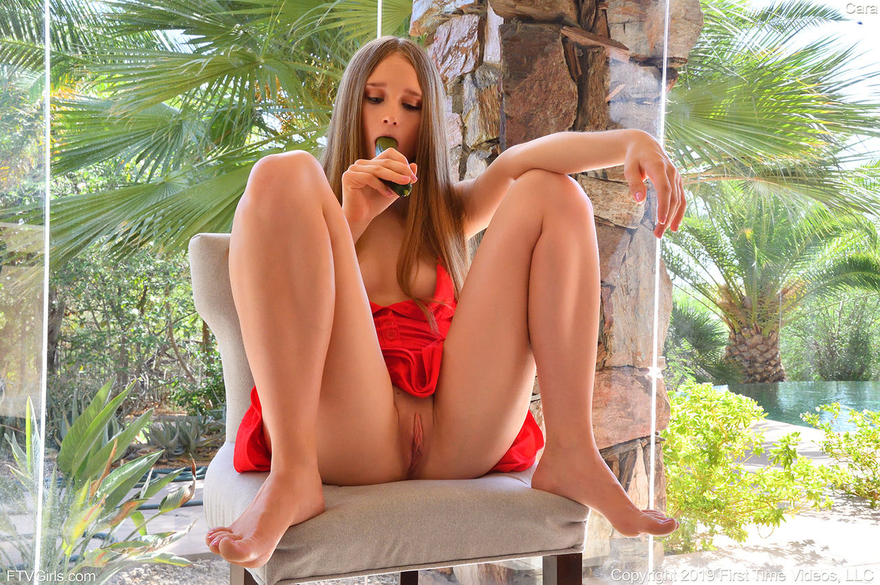 Barefoot amateur rids herself of a red dress while pleasuring her horny pussy