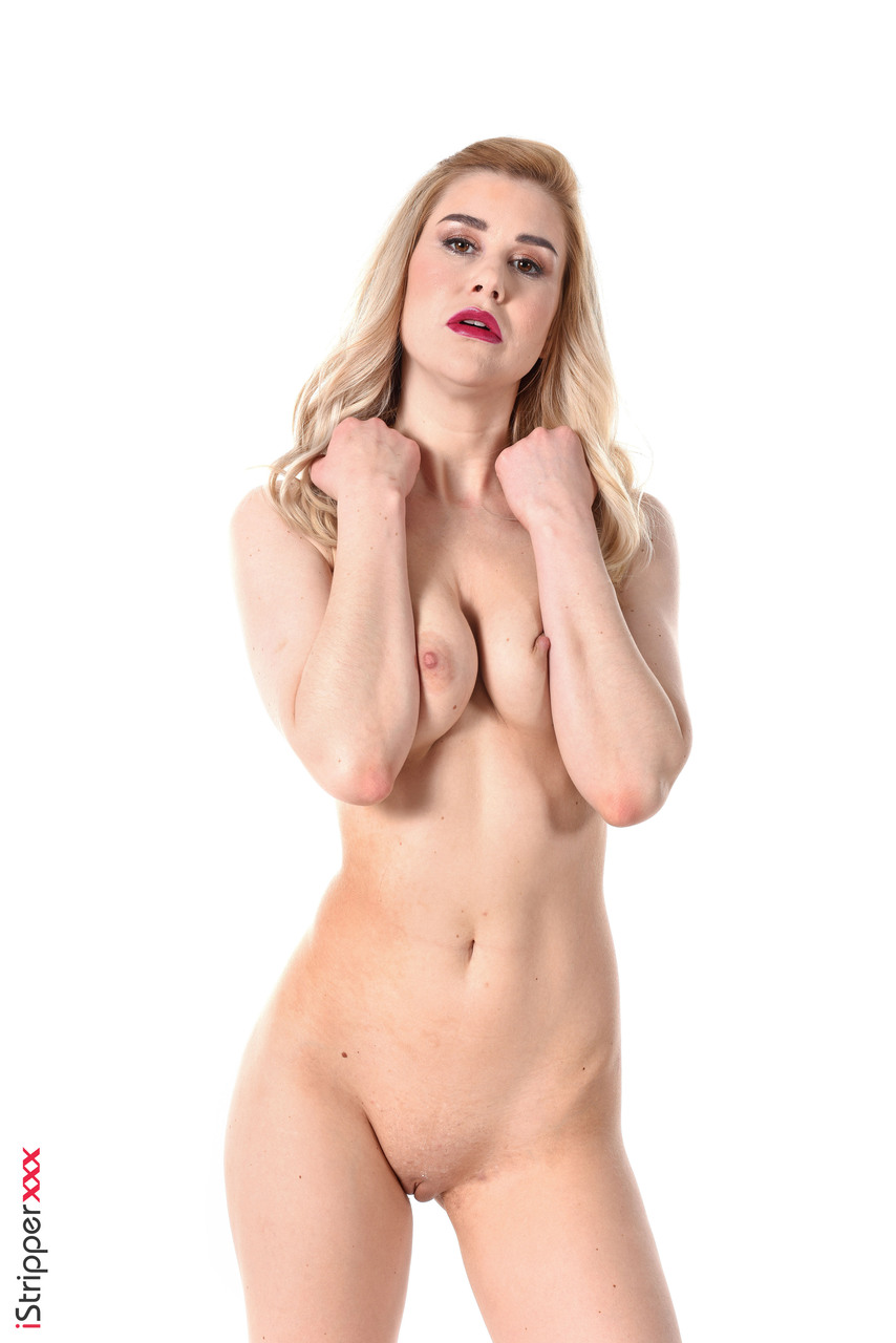 Sexy blonde shoves a dildo up her pussy after licking a crop in fetish clothes
