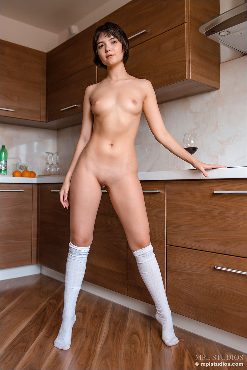 Adorable solo girl shows off her great body in a pair of white knee socks