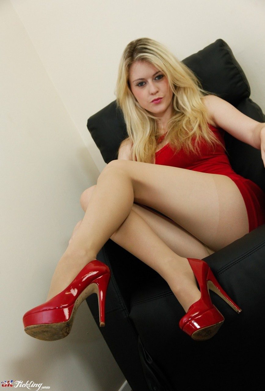 Dirty blonde Brook Little flexes her nylon clad toes after removing her heels