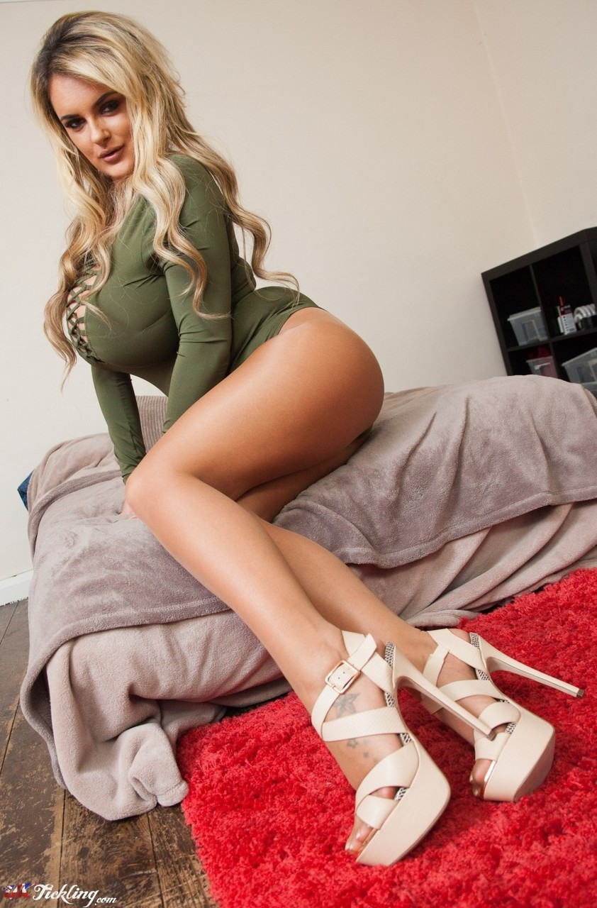 Dirty blonde British model Katie Thornton uncorks her giant tits in pantyhose