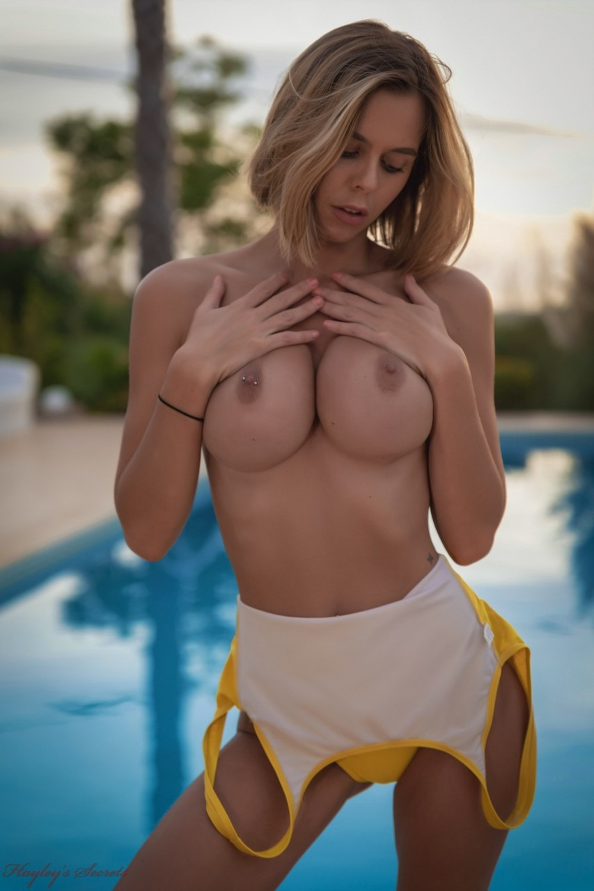 British girl Jennifer Ann slowly peels off her swimsuit on poolside patio