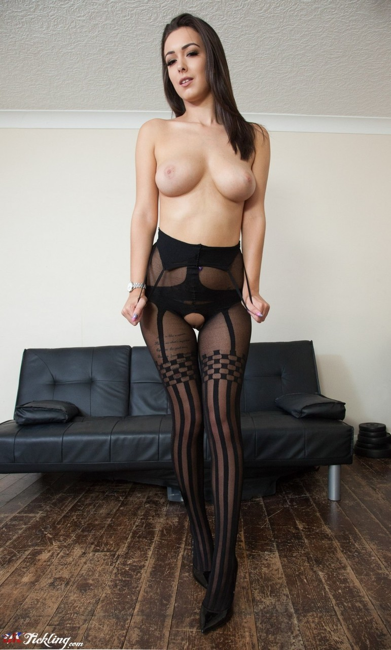 British model Lauren Louise bares her nice tits before showing hose clad feet