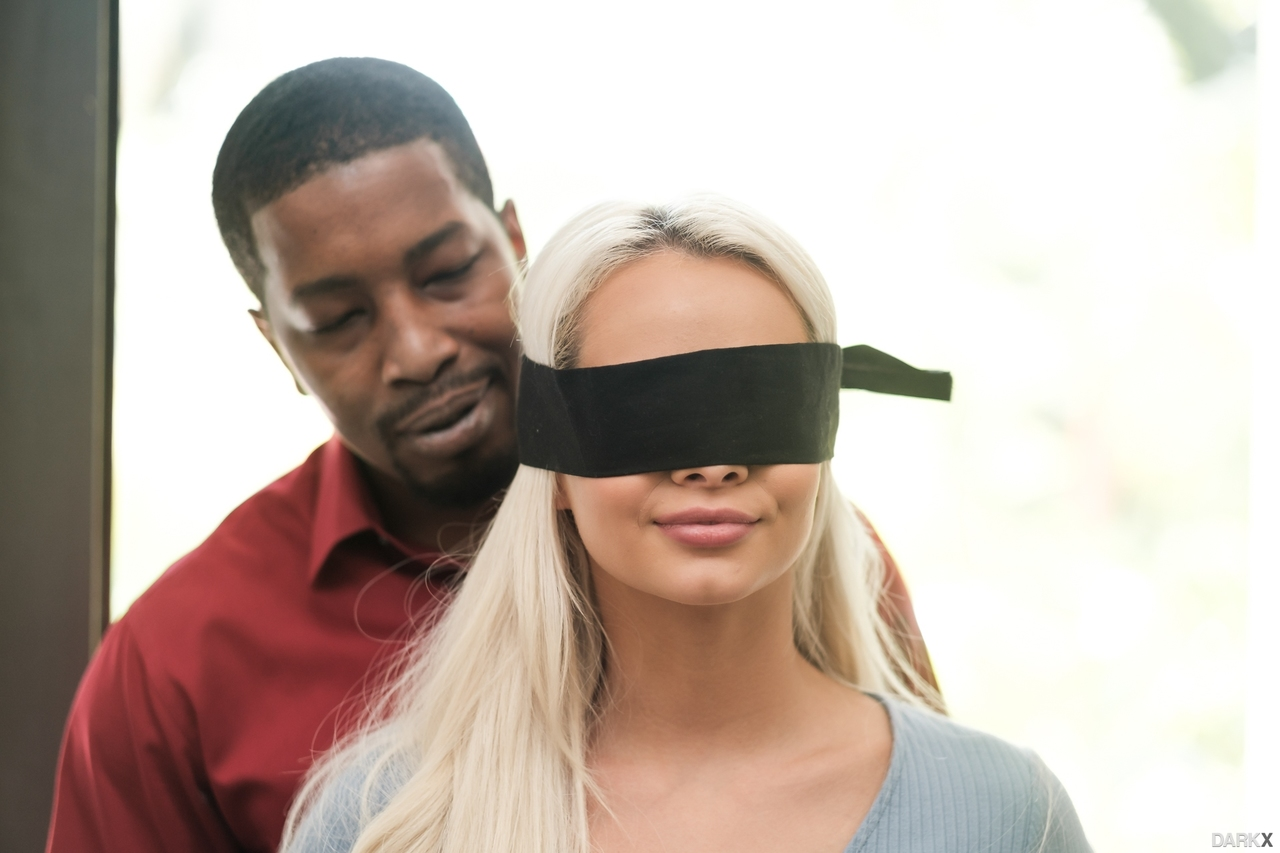 Hot girl Elsa Jean is freed from a blindfold prior to her interracial fucking