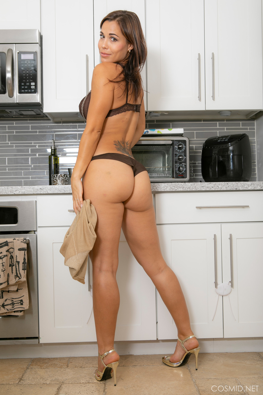 Latina amateur Satene Castro touts her booty after disrobing in the kitchen