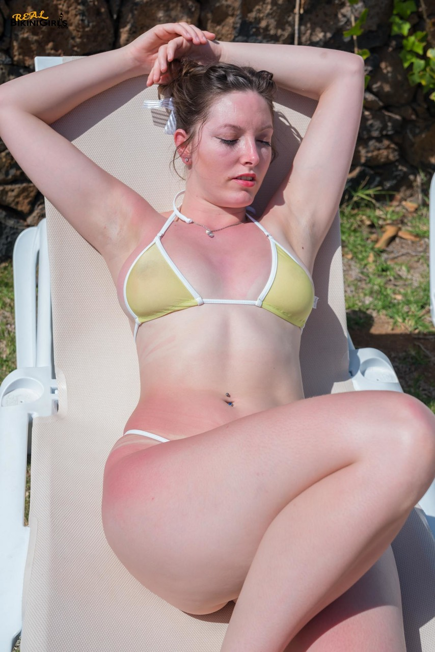 Amateur chick with bare legs frees her big naturals from bikini top outside