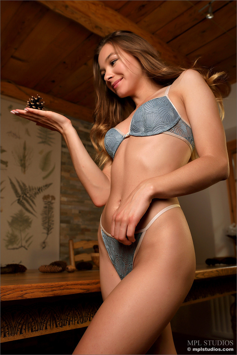 Sweet girl works her hot body free of a bra and panty set in solo action