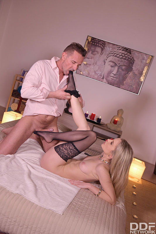 Blonde chick Rose has her heels sniffed before her man removes her hosiery